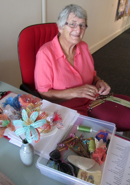 Grand Supreme (Arts and Crafts) Champion of the Bega Show, Rita Roberts making dainty with the laceworks.