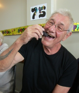 Rogero nibbles the Poo at  his 75th birthday lunch yesterday.